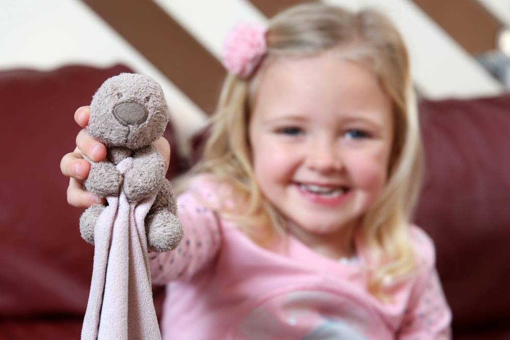 PIC BY MIKEY JONES / CATERS NEWS - (PICTURED DAISY WITH THE TEDDY BEAR) - An adorable four-year-old that lost her favourite teddy on the motorway has been reunited with the tiny bear thanks to the help of an intrepid road worker. Little Daisy Jewkes, 4, was distraught when Old Teddy flew out of the window of her parents car as they drove down the M6 near Cannock. But after her mum Nicola, 36, emailed the Highways Agency, road worker David Smith spent a week looking for the bear and managed to track him down and return him to a delighted Daisy. SEE CATERS COPY