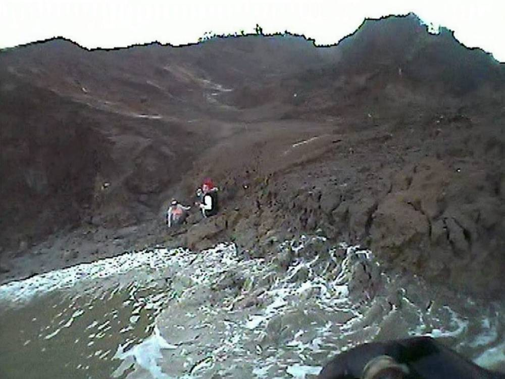 Two teenagers who tried to take a short cut across a mud flat had to call 999 after they got STUCK. See MASONS story MNSTUCK;  The girls - aged 13 and 15 - had been walking along the base of a cliff on the Isle of Sheppey in Kent when they were sucked into the ground. As a result they were left helplessly stuck nearly a mile from the shore but luckily they were carrying mobile phones and were able to call for help. Fire crews arrived but were unable to reach the pair so instead a lifeboat had to reach them by sea as the light faded on Saturday (13/12) afternoon. And the rescue attempt was made even more difficult as the high tide began to approach as evening set in.