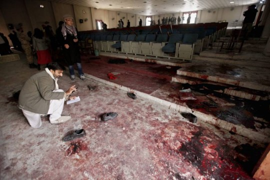 epa04531998 A view of the blood stained auditorium of Army Public School that was attacked by the Taliban militants in Peshawar, Pakistan, 17 December 2014. Pakistan began three days of mourning on 17 December for the 132 children and nine school staff killed in the deadliest ever attack by the Taliban. Seven Taliban insurgents stormed an army-run school in the north-western city of Peshawar on 16 December and went on an eight-hour killing spree that claimed at least 141 lives. Flags were lowered to half-mast for three days in all official buildings and Pakistani missions abroad.  EPA/BILAWAL ARBAB