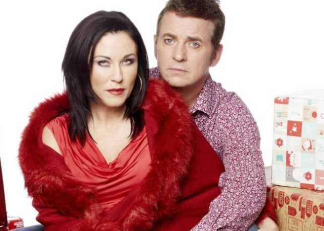 WARNING: Embargoed for publication until: 06/12/2014 - Programme Name: EastEnders - TX: 25/12/2014 - Episode: 4983 (No. n/a) - Picture Shows: Moons at Christmas. Alfie Moon (SHANE RICHIE), Kat Moon (JESSIE WALLACE) - (C) BBC - Photographer: Nicky Johnston