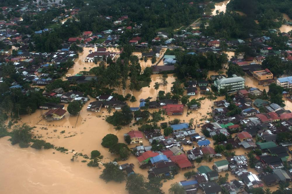 This aerial view shows houses submerged in floodwaters in Pengkalan Chepa, near Kota Bharu on December 27, 2014. Malaysia's worst flooding in decades forced more than 100,000 people to flee as premier Najib Razak came under fire after photos showed him golfing with US President Barack Obama during the storms. AFP PHOTO / MOHD RASFANMOHD RASFAN/AFP/Getty Images