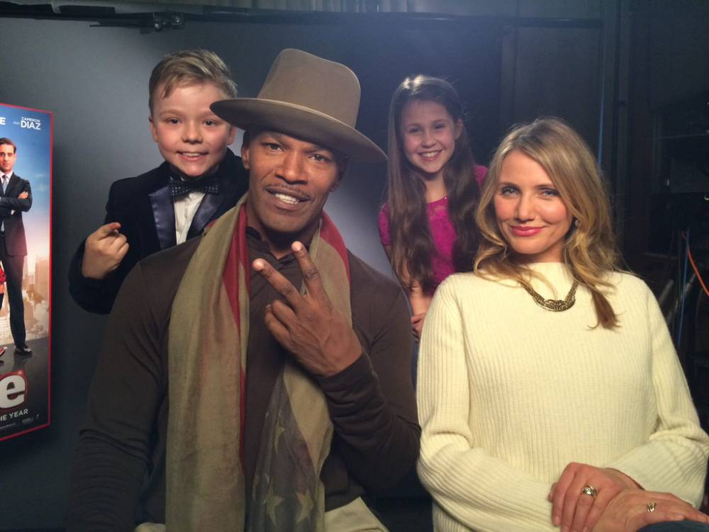 """Collect photo of Ben with Cameron Diaz and Jamie Foxx after interviewing them.  Child actor Ben stunned A-list actress Cameron Diaz when he asked her out on a date while he was interviewing her. December 31 2014.   See News Team story NTIDIAZ; Hollywood movie star Cameron Diaz was left gobsmacked when a cheeky British schoolboy actor asked her out ñ on a DATE. Smooth-talking youngster Ben Wilby, 12, chatted up the actress while interviewing her about her latest film Annie which also stars Jamie Foxx. Ben, who stars in the hit movies Nativity alongside Martin Freeman, made the Thereís Something About Mary star blush as he asked her for her telephone number. He asked her: """"OK my final question is for Cameron, well I just got a new phone and I recently lost my number so can I have yours?"""""""