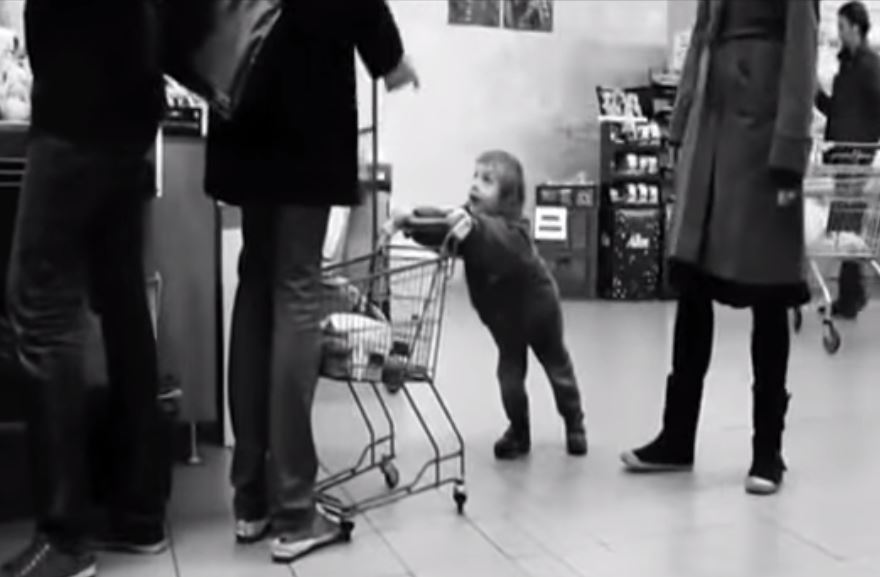 The errant child repeatedly hits the shopper in front (Picture: Youtube/  Kaiken)