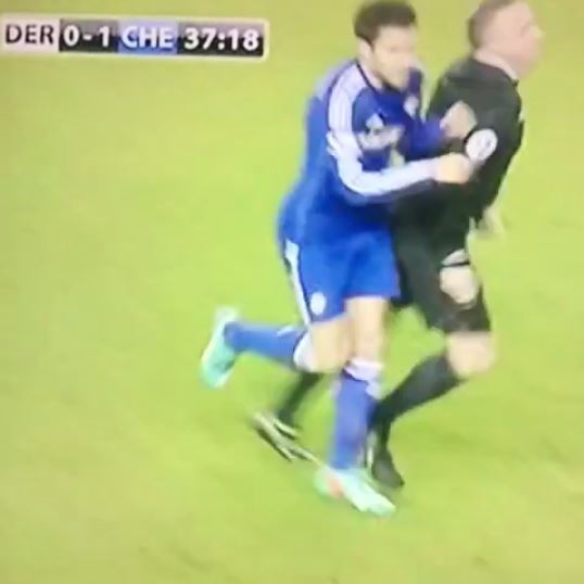 Cesc Fabregas knocks referee Jonathan Moss onto pitch during Chelsea's Cup match against Derby