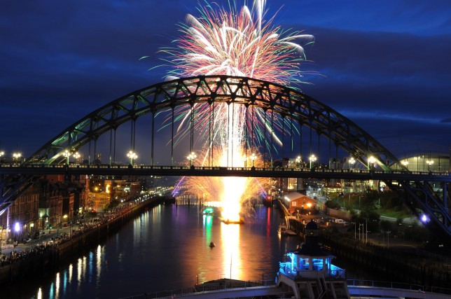 Newcastle on New Year's Eve: The Tyne Bridge at night with fireworks in the background