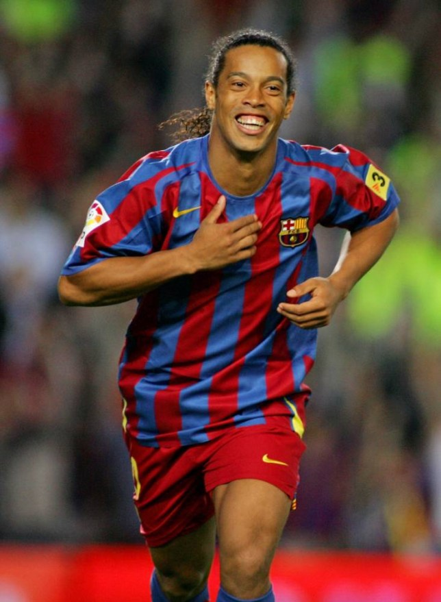 Ronaldinho of Brazil celebrates after scoring against Espanyol during their Spanish first division soccer match at the Nou Camp stadium in Barcelona, Spain May 6, 2006.   REUTERS/Gustau Nacarino