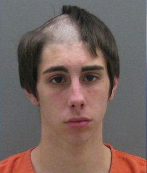Man arrested while shaving his head has best mugshot of all time
