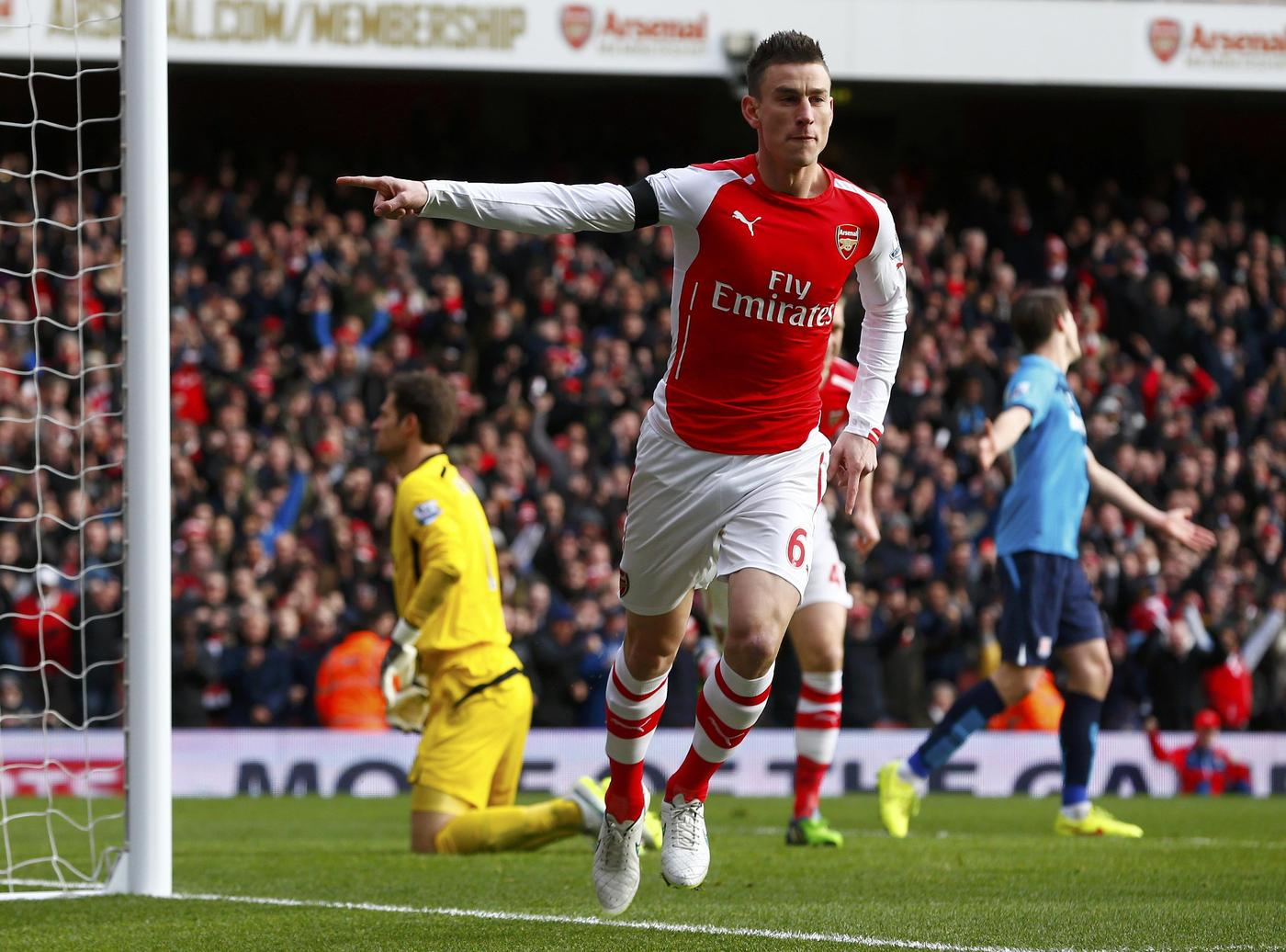 Arsenal's Laurent Koscielny celebrates after scoring a goal during their English Premier League soccer match against Stoke City at the Emirates Stadium in London January 11, 2015. REUTERS/Eddie Keogh (BRITAIN - Tags: SPORT SOCCER TPX IMAGES OF THE DAY) EDITORIAL USE ONLY. NO USE WITH UNAUTHORIZED AUDIO, VIDEO, DATA, FIXTURE LISTS, CLUB/LEAGUE LOGOS OR 'LIVE' SERVICES. ONLINE IN-MATCH USE LIMITED TO 45 IMAGES, NO VIDEO EMULATION. NO USE IN BETTING, GAMES OR SINGLE CLUB/LEAGUE/PLAYER PUBLICATIONS.FOR EDITORIAL USE ONLY. NOT FOR SALE FOR MARKETING OR ADVERTISING CAMPAIGNS. Eddie Keogh/Reuters