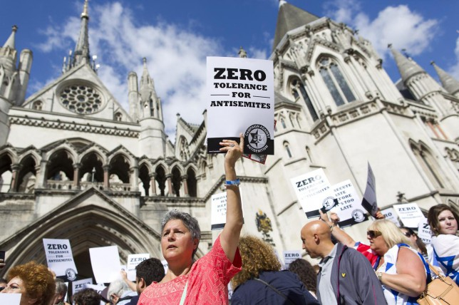 Jewish groups protest outside the Royal Courts of Justice in London on August 31, 2014, as they call for 'Zero Tolerance for Anti-Semitism'. Jewish groups demonstrated outside the British High Court as latest figures published by the Community Security Trust reported a spike in anti-semitic attacks on people and property in the UK following the lastest outbreak of violence between Israel and Palestinians in Gaza. AFP PHOTO / JUSTIN TALLIS JUSTIN TALLIS/AFP/Getty Images