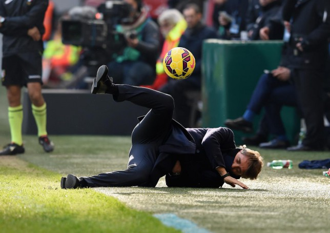 Inter Milan boss Roberto Mancini goes flying after being hit in face by shot from OWN player