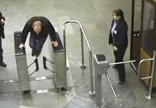 """Pic shows: Ukrainian man Zossima Sozonov attempted to jump over the barrier by putting both hands on either side of the barrier, he still managed to trip and fell flat on his face ¿ knocking himself unconscious in the process.nnAs fare dodgers go Ukrainian man Zossima Sozonov has to be one of the worst.nnThe barriers on the underground network in the city of Kiev are less than a foot high and can be easily stepped over. But after attempting to jump over them by putting both hands on either side of the barrier, he still managed to trip and fell flat on his face ¿ knocking himself unconscious in the process.nnAnd worse, his attempted fare dodging the left him with a cracked head and blood streaming down the side of his face happened in front of a ticket inspector, who promptly booked him.nnIt was also captured on CCTV, where it was seen by watchful security agents who had recorded it, and later released the video as a warning to people about the fact that they needed to pay for their tickets.nnKiev metro operator spokesman Leo Aksakov said: """"We don't make the barriers very high because we hope that people will respect the need to pay for the service, and it's more of a symbolic gesture just to remind people more than anything else. But it seems that even a symbolic gesture was too much for this man, who may we hope now along with others think twice before attempting to avoid buying a ticket.""""nnHe said the video had been shot at the Klovsk metro station in the city and that the man had been unconscious for 10 seconds but had of Kiev tried to jump through the ticket control.nn(ends)nnn"""