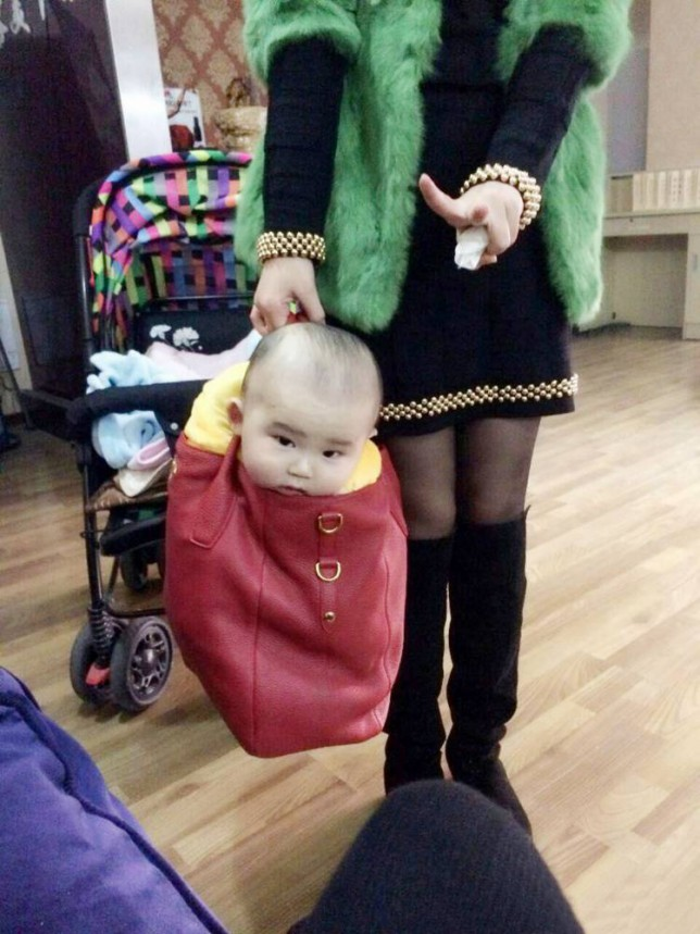 """Pic shows: A Chinese mum carries her baby son around like a pet dog in a designer handbag.nnThis photograph by a Chinese mum of her baby son being carried around like a pet dog in a designer handbag has caused outrage and debate after it went viral.nnXue Hsueh, 26, had been off to meet friends and one of her pals took a snap of her nine-month-old son which she sent to Xue, who liked it so much she uploaded it online.nnBut it quickly became widely shared where many commented on the fact that last year young women liked to be seen with lapdogs to complete their outfits, and now the trend seemed to be for babies.nnUser WuLei34 posted: """"Designer babies, the latest accessory that every woman must have.""""nnAnd another LucyX added: """"I wonder what she will do when the straps break on her handbag?""""nnHowever a defiant Xue defended the pictures, posting online that the baby had only been in the handbag briefly while she chatted to her friends and said she had been making a joke about how men usually look after babies.nnShe said she had just wanted to illustrate what childcare would be like if it was left to a man, and posted the pictures online because they look sweet and to raise a smile.nnShe also said that it was clear that her son thought it was fun being in the bag and the picture showed he was enjoying himself.nn(ends)n"""