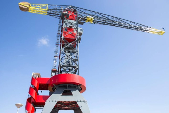 Pictured -The hotel Faralda in Amsterdam, Holland.  See Ross Parry copy RPYCRANE. This historic port crane was in ruins and labelled ìimpossibleî to develop, but after three years it has become one of the swankiest and unique hotels in Holland.  After years of development fraught with technical difficulties, one of the oldest and highest maritime cranes in the world is officially open for business. This monumental 50-metre high port crane had been decaying but now hosts three luxurious design hotel suites and a TV broadcasting studio. The high-end suites are each decorated by a top team of interior designers. The top of the crane hosts a luxury spa pool with a panoramic view over Amsterdam and the river.