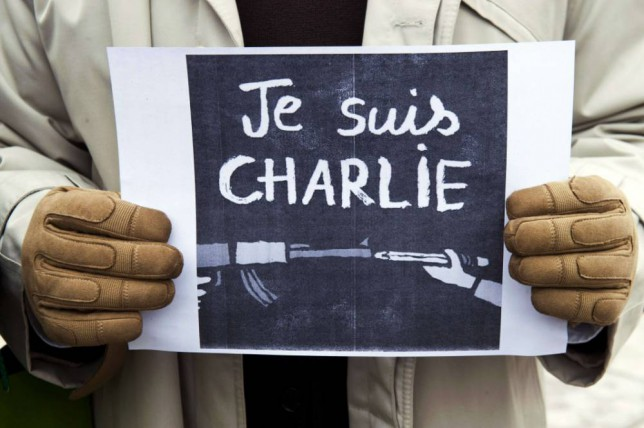 "A journalist holds a placard reading in French"" I am Charlie"" during a gathering on the streets of Pristina on January 8, 2015 in solidarity with the victims of the shooting at the Paris office of the satirical newspaper Charlie Hebdo which left 12 people dead. A stunned and outraged France began a national day of mourning on January 8, as security forces desperately hunted two brothers suspected of gunning down 12 people in an Islamist assault on a satirical weekly, the country's bloodiest attack in half a century. AFP PHOTO/ ARMEND NIMANIARMEND NIMANI/AFP/Getty Images"
