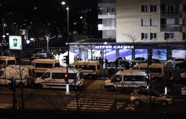 """French police vehicles take position outside the Hyper Casher kosher grocery store near Porte de Vincennes in eastern Paris on January 9, 2015 after police launched an assault killing the gunman holed up in the market and freeing the hostages. The gunman killed by police after taking hostages at a Jewish supermarket in Paris told BFMTV station he had """"co-ordinated"""" with the suspected Charlie Hebdo attackers and belonged to the Islamic State group. AFP PHOTO / ERIC FEFERBERGERIC FEFERBERG/AFP/Getty Images"""