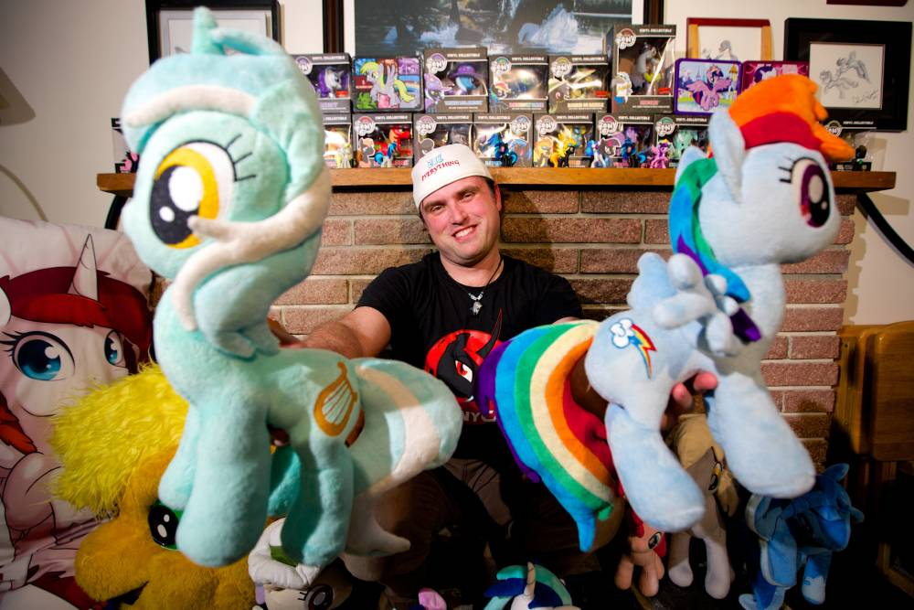 PIC BY AMANDA PALMER / CATERS NEWS - (PICTURED: ROB WITH SOME OF HIS MY LITTLE PONY COLLECTION) - Meet Rob Harrison - a grown man so obsessed with My Little Pony he has spent thousands feeding his unusual passion. Rob is part of a legion of male fans around the world in love with the animation - a group so large they even have their own nickname bronies. He loves watching characters such as Twilight Sparkle, Fluttershy and Applejack cantering across his screen every week. The IT consultant, 34, has filled his home with memorabilia from plush toys to full body costumes he and his fellow bronies wear to conventions. Rob, from Vancouver in B.C., Canada, admits he knows people will laugh at his obsession but insists is doesnt bother him. SEE CATERS COPY
