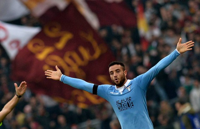 Lazio's midfielder from Brazil Felipe Anderson celebrates after scoring during the Italian Serie A football match AS Roma vs Lazio at the Olympic stadium on January 11, 2015 in Rome. AFP PHOTO / TIZIANA FABITIZIANA FABI/AFP/Getty Images