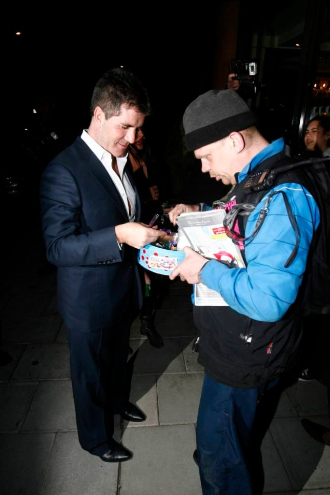 Simon Cowell was dining at C Restaurant in London, as he was leaving the resturant he generously gave a homeless person some money and took some chocolate from the homeless man...<P>..Pictured: Simon Cowell..<B>Ref: SPL272588  280411  </B><BR />..Picture by: Splash News<BR />..</P><P>..<B>Splash News and Pictures</B><BR />..Los Angeles:t310-821-2666<BR />..New York:t212-619-2666<BR />..London:t870-934-2666<BR />..photodesk@splashnews.com<BR />..</P>