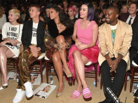 Don't look now Kim! Kanye West sneaks a cheeky peek at Katy Perry's legs and likes what he sees