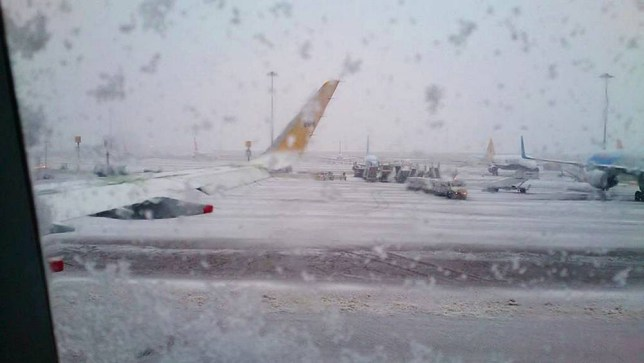 UK weather: Manchester Airport closed as snow batters