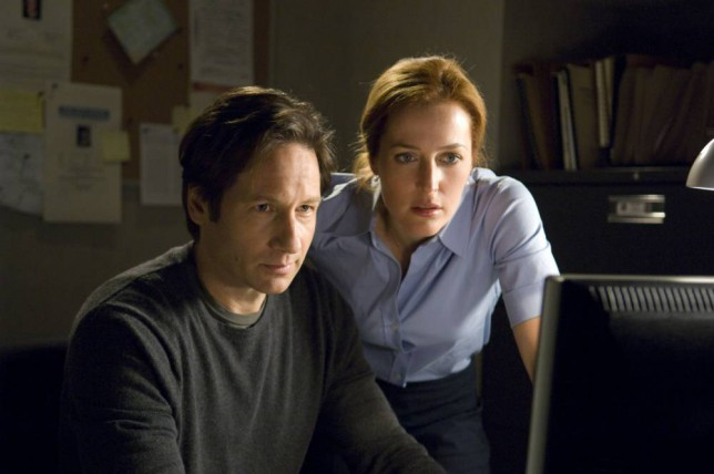 Film: The X-Files I Want To Believe (2008). David Duchovny and Gillian Anderson in a scene from the film.