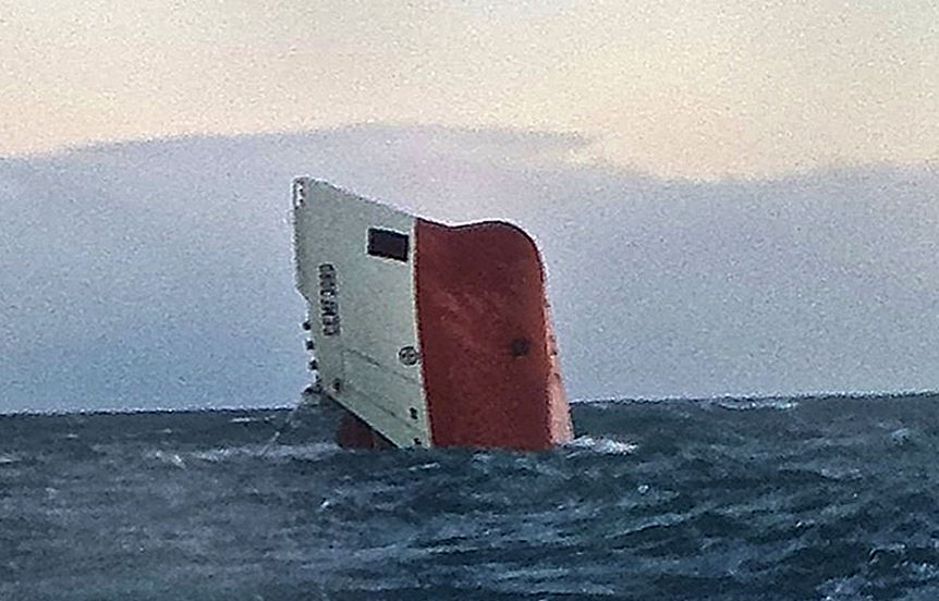 Search resumes off the Scottish coast for the eight missing crew of an overturned ship