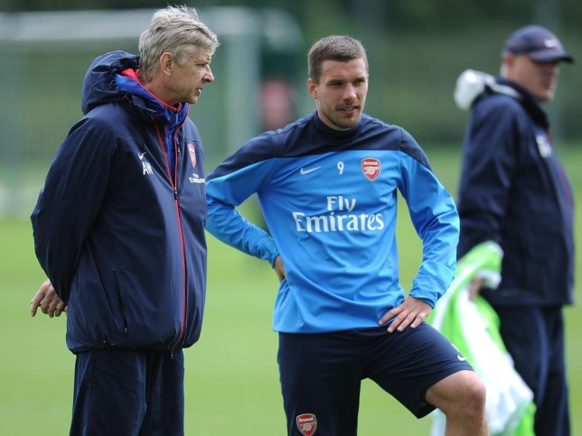 Lukas Podolski, right, has had a pop at Arsenal boss Arsene Wenger (Picture: Getty)