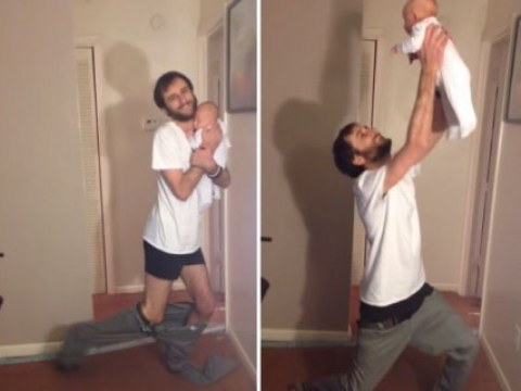 He's totally got this: Dad manages to put his trousers on while holding the baby