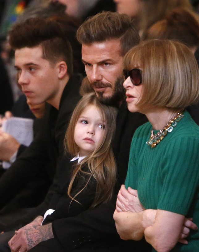 David Beckham, center, sits in the front row next to Anna Wintour, right, along with his son, Brooklyn, left, daughter, Harper, before the Victoria Beckham Fall 2015 collection show during Fashion Week, Sunday, Feb. 15, 2015, in New York. (AP Photo/Jason DeCrow) AP Photo/Jason DeCrow