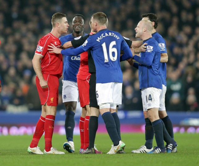 Liverpool midfielder Jordan Henderson gets into combat mode with Amir Khan