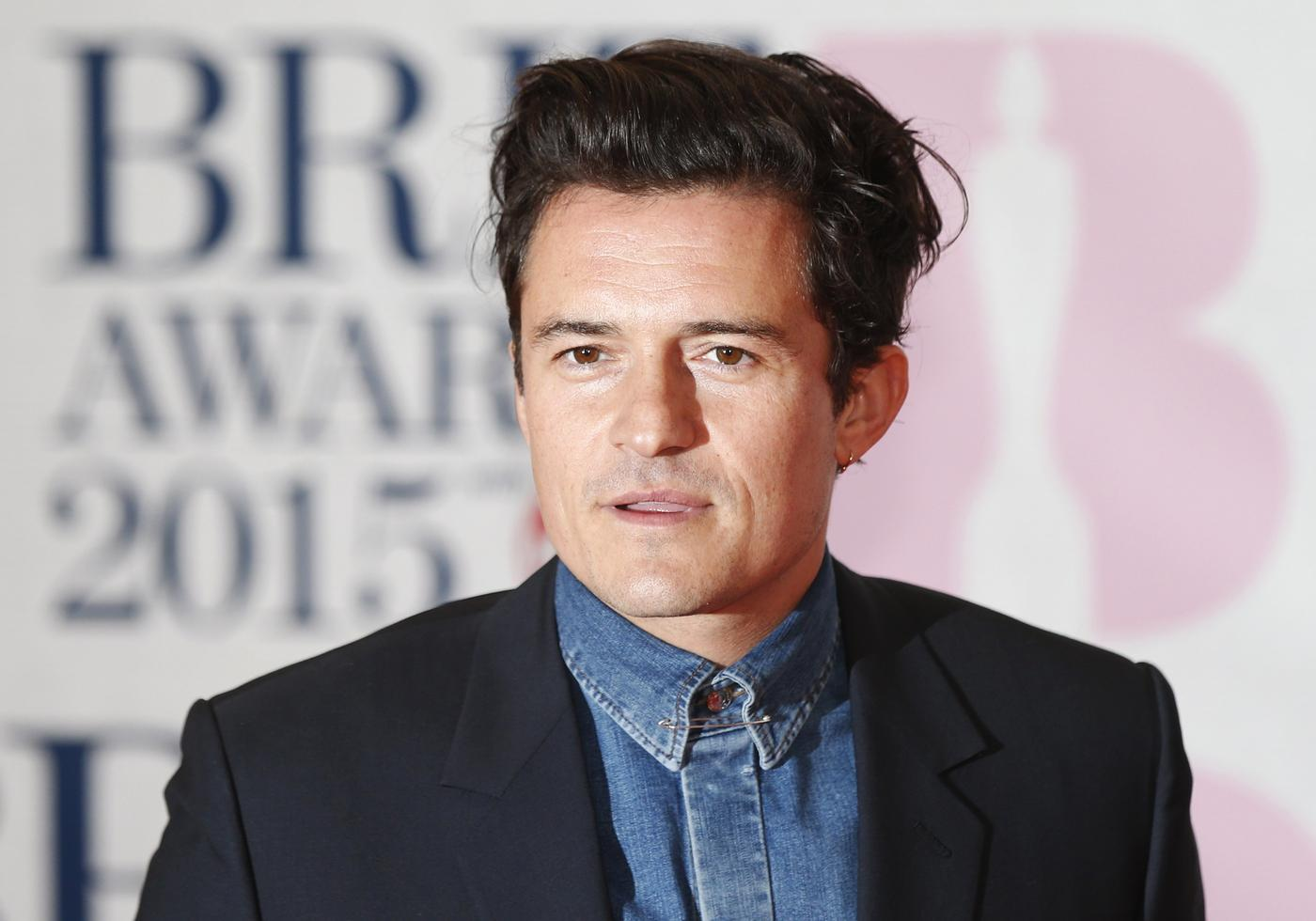Orlando Bloom jokes he's about to embark on a music career after dishing out prize at Brit Awards