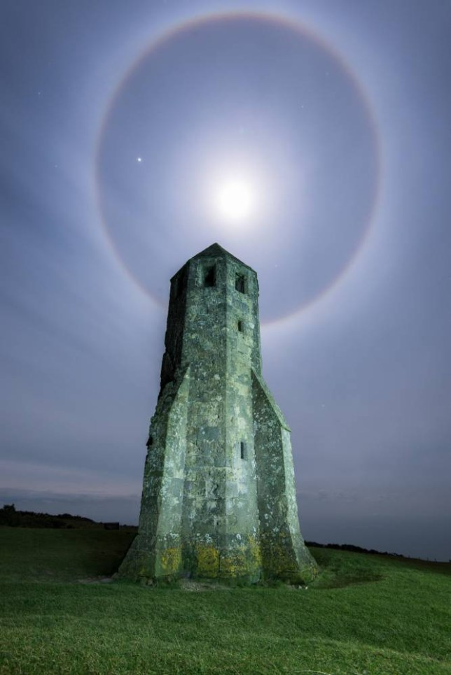 ISLE OF WIGHT, FEBRUARY 02: A picture of the moon surrounded by a halo of light on February 02, 2015 in Isle Of Wight, England. Jupiter is the brightest star on the left side of the halo. The moon produces a strong HALO at around midnight. The rings can be clearly seen in the high stratus clouds. Jupiter can be seen shining brightly to the left of the moon. The stunning photograph was taken by Jason Hedges, 41 at his home in West Wittering in Sussex. The photographer spotted the incredible sight just before midnight and decided to capture the incredible sky display on camera. PHOTOGRAPH BY Ainsley Bennett / Barcroft Media UK Office, London. T +44 845 370 2233 W www.barcroftmedia.com USA Office, New York City. T +1 212 796 2458 W www.barcroftusa.com Indian Office, Delhi. T +91 11 4053 2429 W www.barcroftindia.com