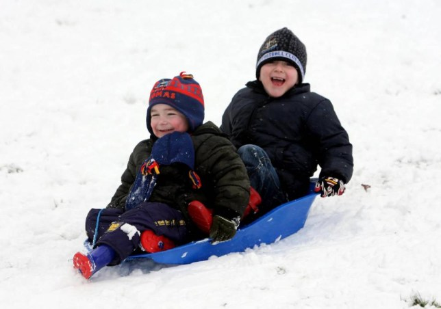 Three year old Sam Davies and six year old Jack Davies play on their sledge on the Old Hills in Worcestershire. PRESS ASSOCIATION Photo. Picture date: Thursday February 8, 2007. The Met Office issued a severe weather warning for England, Wales and Northern Ireland, industry chiefs warned that transport failures today could cost the economy hundreds of millions of pounds. Forecasters predicted up to 6in (15cm) of snow could fall over parts of the Midlands, South and Mid-Wales and Northern Ireland today. See PA story WEATHER Snow. Photo credit should read: David Davies/PA Wire