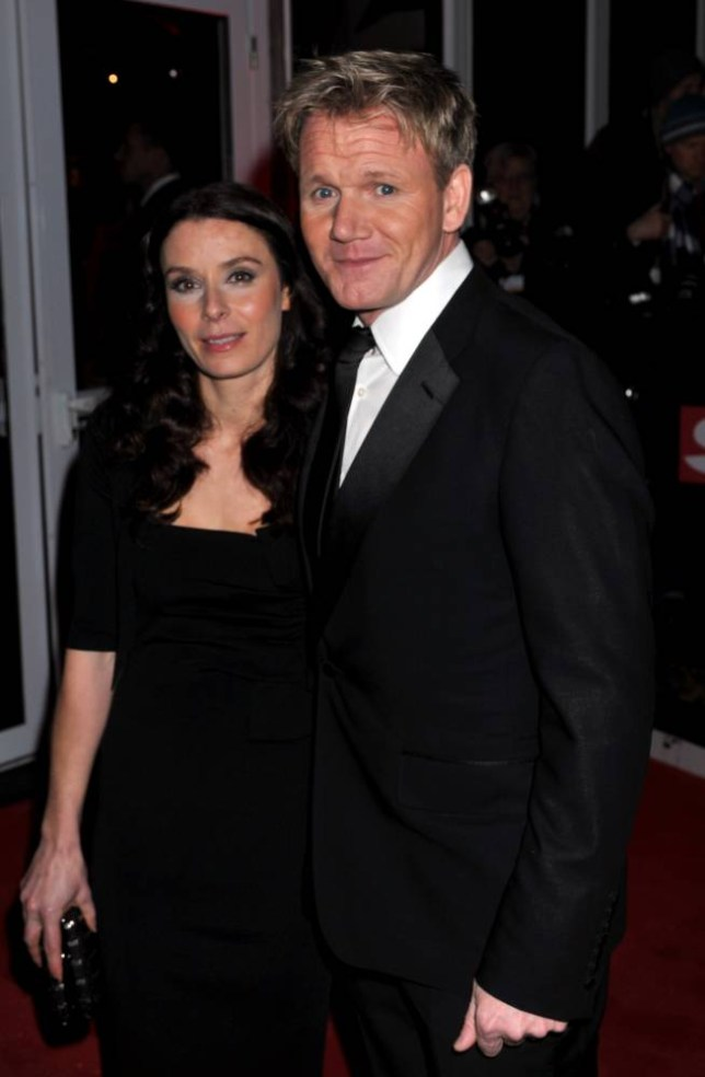 """Gordon Ramsey (R) and his wife Tana arrive at the Imperial War Museumattend """"A Night of Heros"""", the annual Sun Military Awards, to honour members of the British armed forces in London on December 19, 2011.      AFP PHOTO/ WPA POOL/ JOHN STILLWELL (Photo credit should read JOHN STILLWELL/AFP/Getty Images)"""