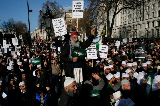 "Muslim demonstrators hold placards during a protest against the publication of cartoons depicting the Prophet Mohammad in French satirical weekly Charlie Hebdo, near Downing Street in central London February 8, 2015. At least 1,000 British Muslims protested in central London on Sunday against what they called ""insulting depictions"" of the Prophet Mohammad by French newspaper Charlie Hebdo. The event comes weeks after 17 people were killed in three days of violence last month in France that began when two Islamist gunmen burst into Charlie Hebdo's Paris offices, opening fire in revenge for its publication of satirical images of Mohammad. Sunday's protest organisers condemned the Paris attacks, but said the magazine should not publish cartoons of the prophet. REUTERS/Stefan Wermuth (BRITAIN - Tags: POLITICS RELIGION CIVIL UNREST TPX IMAGES OF THE DAY)"