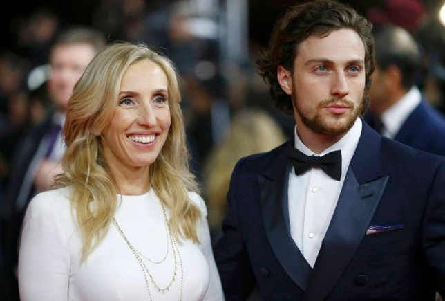 Director Sam Taylor-Johnson and her husband actor Aaron Taylor-Johnson (R) arrive for the screening of the movie 'Fifty Shades of Grey' at the 65th Berlinale International Film Festival in Berlin February 11, 2015. REUTERS/Hannibal Hanschke (GERMANY - Tags: ENTERTAINMENT)