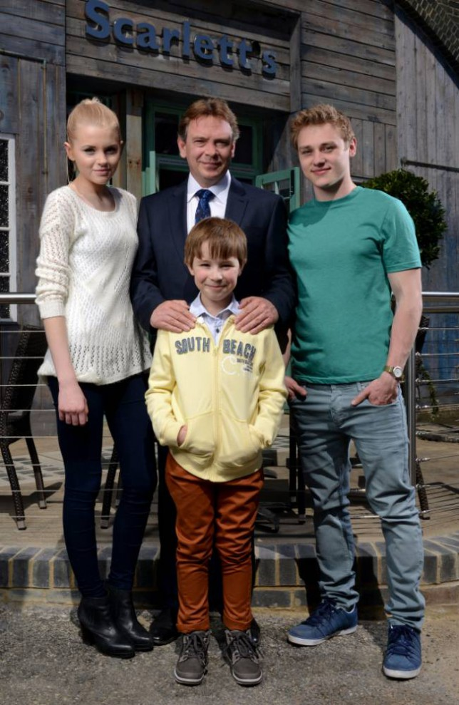 WARNING: Embargoed for publication until 07/06/2013 - Programme Name: EastEnders - TX: n/a - Episode: n/a (No. n/a) - Picture Shows: (L-R) Lucy Beale (HETTI BYWATER), Ian Beale (ADAM WOODYATT), Bobby Beale (RORY STROUD), Peter Beale (BEN HARDY) - (C) BBC - Photographer: Kieron McCarron