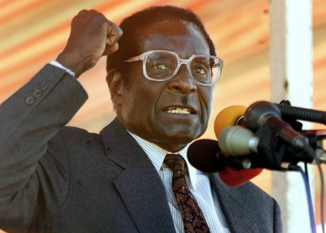 HARARE, ZIMBABWE:  Zimbabwean President Robert Mugabe addresses Zanu PF followers at a rally in the Harare suburb of Highfield, 17 June 2000. Some 5,000 people gathered to hear their President's speech a week ahead of the 24-25 June parliamentary elections. (ELECTRONIC IMAGE) AFP PHOTO ODD ANDERSEN (Photo credit should read ODD ANDERSEN/AFP/Getty Images)