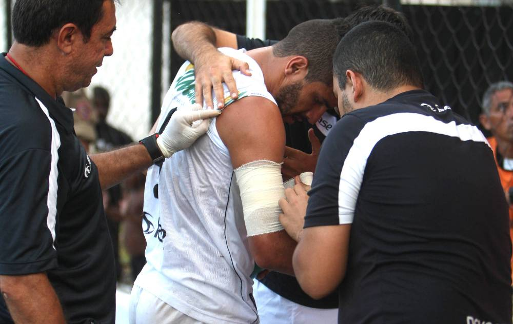 Ouch! Player bitten by dog during Brazilian league game