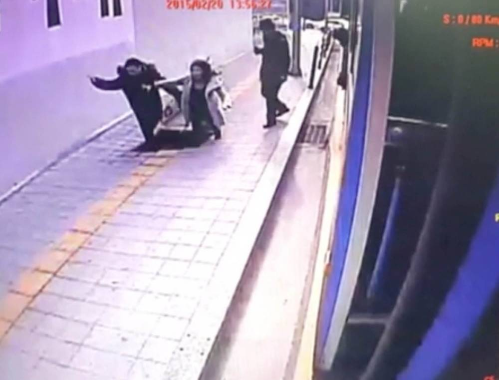 ****Ruckas Videograbs****  (01322) 861777 *IMPORTANT* Please credit Sky News for this picture. 24/02/15 Grabs from CCTV footage of two people in South Korea falling down a sinkhole after the pavement they were walking on opened up in Seoul. The footage also shows the rescue of the two people, who only suffered minor injuries. Office  (UK)  : 01322 861777 Mobile (UK)  : 07742 164 106 **IMPORTANT - PLEASE READ** The video grabs supplied by Ruckas Pictures always remain the copyright of the programme makers, we provide a service to purely capture and supply the images to the client, securing the copyright of the images will always remain the responsibility of the publisher at all times. Standard terms, conditions & minimum fees apply to our videograbs unless varied by agreement prior to publication.