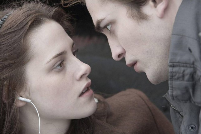 Film: Twilight (2008). Kristen Stewart as Bella Swann and Robert Pattinson as Edward Cullen.