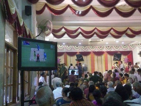 Cricket fans watch India and Pakistan's ICC World Cup match during wedding