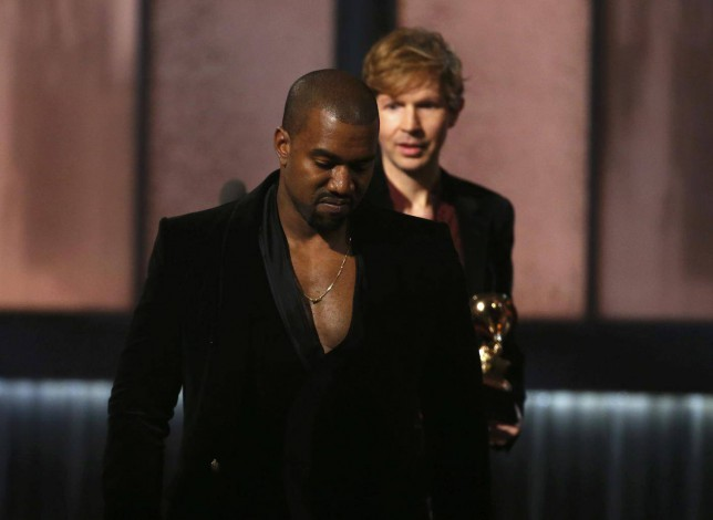 Kanye West gatecrashes the Grammys stage AGAIN during Beck's speech – but then changes his mind to 'protect his clothing line'