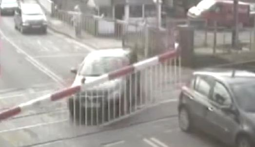 This is how you die on level crossings: Police CCTV footage reveals three near-misses as warning to drivers