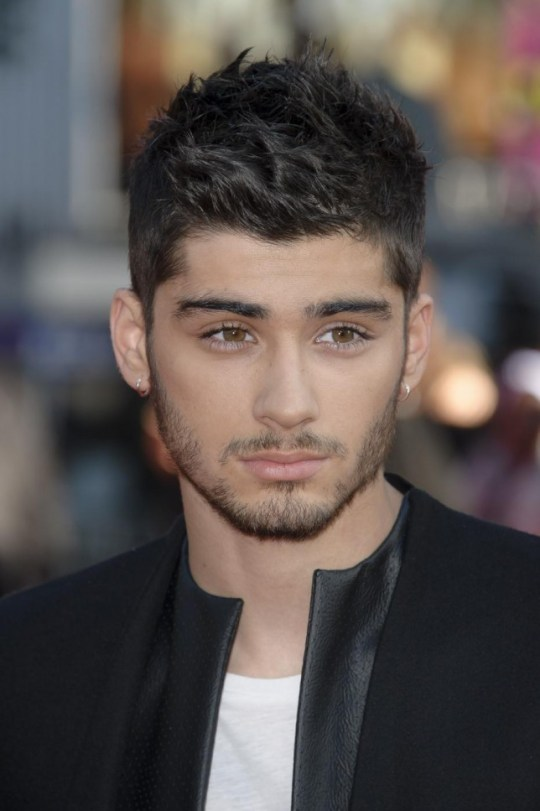 File - Zayn Malik flies home from One Direction tour with stress in this Tuesday, Aug. 20, 2013 file photo Zayn Malik arrives for the UK Premiere of 'One Direction: This Is Us 3D' at a central London cinema, (Photo by Jonathan Short/Invision/AP, file) Jonathan Short/Invision/AP, file