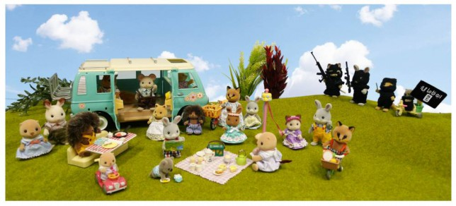 Sylvanian Family dolls enjoy a picnic, whilst dolls dressed up like ISIS lurk in the background