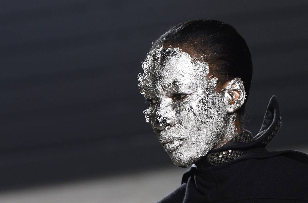 A model presents a creation by Rick Owens during the 2015-2016 fall/winter ready-to-wear collection fashion show on March 5, 2015 in Paris.    AFP PHOTO / BERTRAND GUAYBERTRAND GUAY/AFP/Getty Images