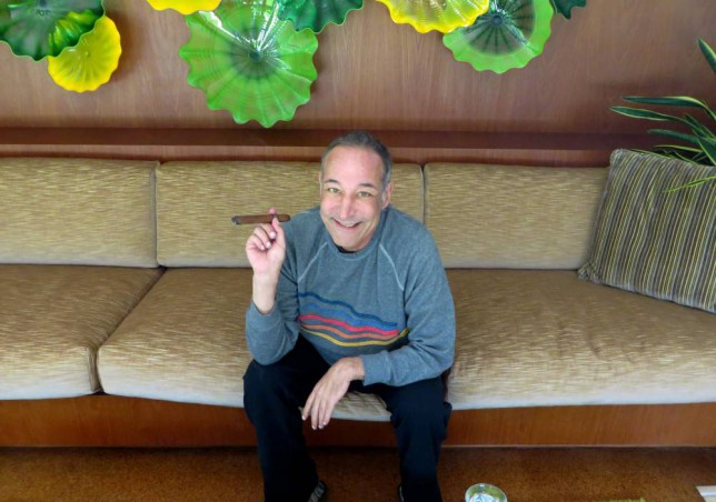 """FILE - This Aug. 12, 2013 file photo shows Sam Simon, co-creator of """"The Simpsons,"""" at his home in Pacific Palisades, Calif.  Simon, who made a midlife career shift into philanthropy and channeled much of his personal fortune into social causes including animal welfare, has died Sunday, March 8, 2015, after a long bout with cancer.  He was 59. (AP Photo/Frazier Moore, File)"""