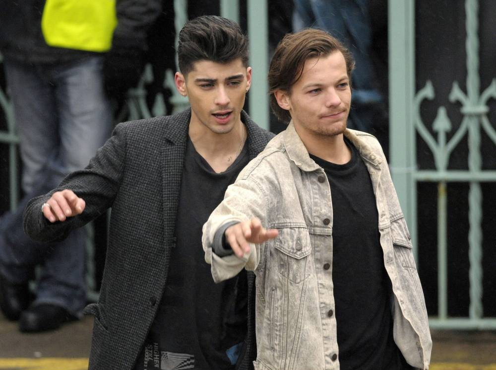 Mandatory Credit: Photo by London News Pictures/REX (3670582d)  Zayn Malik and Louis Tomlinson  One Direction on the Set of Their New Music Video, Clevedon Pier, Somerset, Britain - 24 Mar 2014