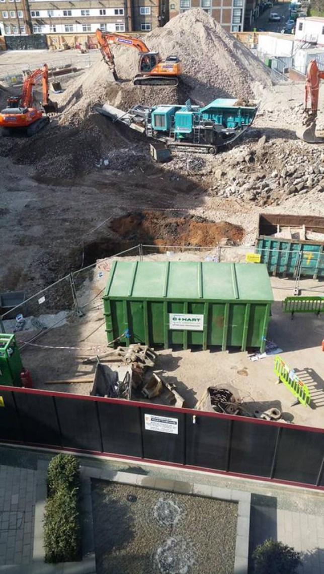 Undated handout photo from the Twitter feed of @JamesClarke91, of the scene on a building site where a huge unexploded bomb from the Second World War has been found, the 1,000lb ordnance, measuring five foot long with a tail fin, was found by construction workers in Bermondsey, south-east London.  PRESS ASSOCIATION Photo. Issue date: Monday March 23, 2015. See PA story POLICE Bomb. Photo credit should read: James Clarke/PA Wire NOTE TO EDITORS: This handout photo may only be used in for editorial reporting purposes for the contemporaneous illustration of events, things or the people in the image or facts mentioned in the caption. Reuse of the picture may require further permission from the copyright holder.
